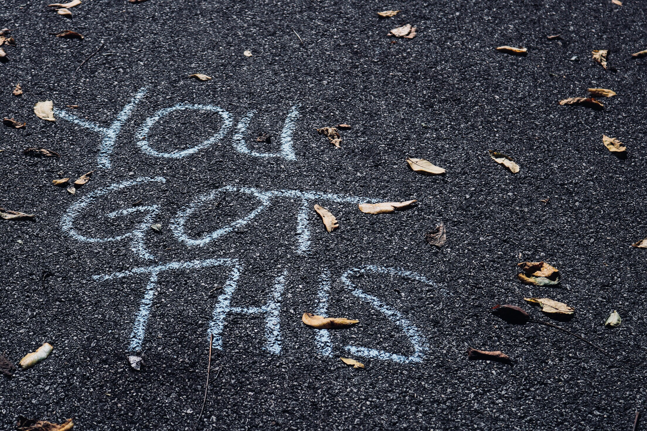 You Got This written in chalk on the pavement.