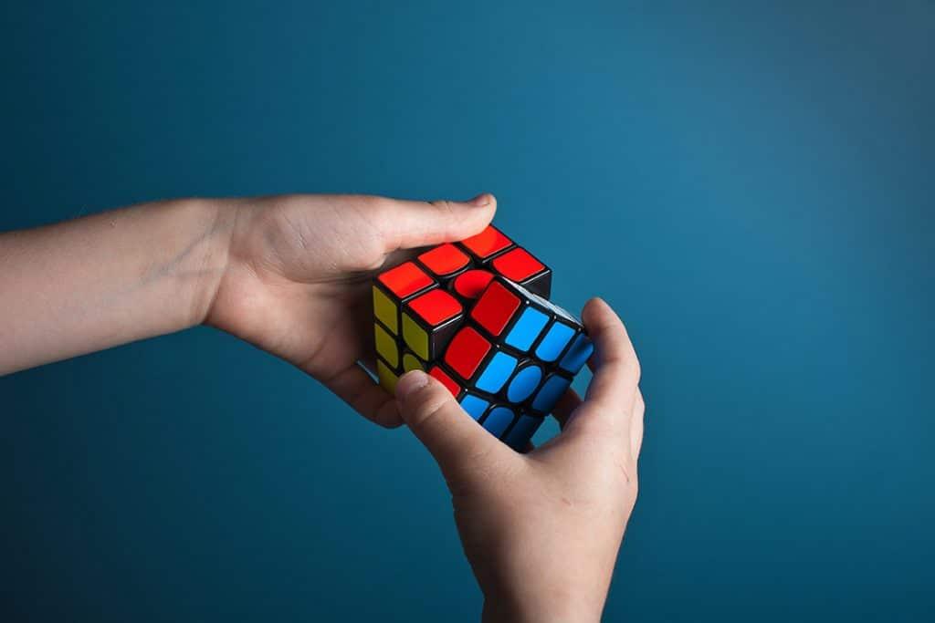 Someone finishing a Rubik Cube.