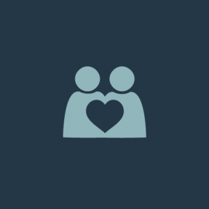 A teal icon of two people next to one another with a heart growing in the middle. Growing your family connections.